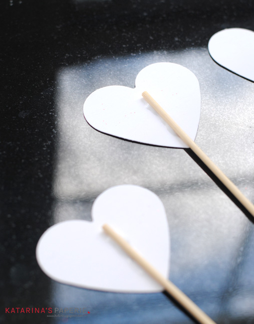 Gluing hearts on kabob sticks